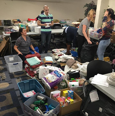 4 volunteers in  the picture are sorting out the donations items